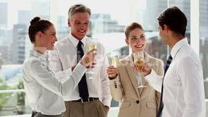 Cheerful business team celebrating with champagne