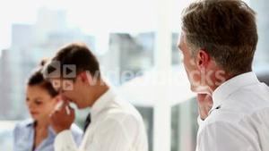 Serious businessman having a phone discussion