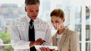 Two business people working on tablet