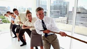 Business people pulling a rope together