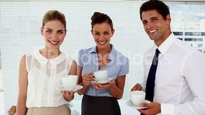 Smiling business people having a conversation at break time