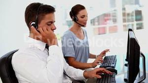 Business man and business woman in a call centre
