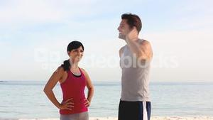 Couple of joggers running on the beach