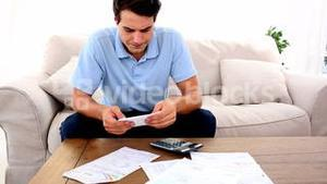 Man stressed with so many bills to pay