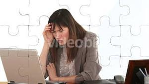 White figure holding jigsaw pieces to solve business problem