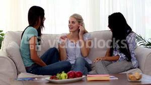 Excited woman gesturing while discussing with friends