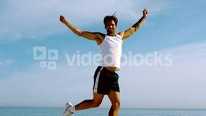 Sportsman jumping on the beach