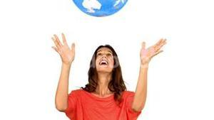 Woman throwing a globe on white background