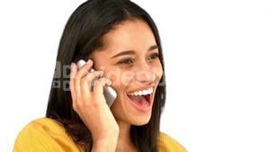 Woman talking on the phone on white background