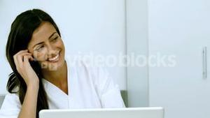Woman laughing during a phone conversation
