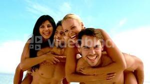 Friends joking and having fun on the beach