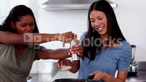 Laughing friends cooking together
