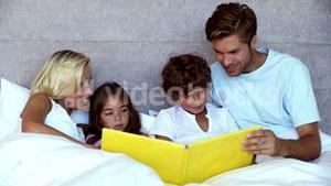 Parents reading a story to their children