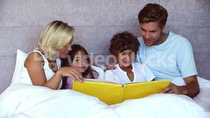 Parents reading a funny story to their children