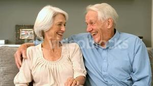 Elderly couple laughing at home