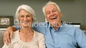 Elderly couple smiling and looking to the camera