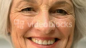 Old cheerful woman smiling