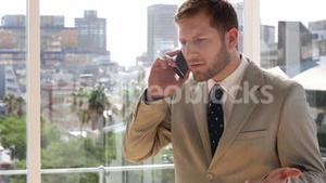 Businessman getting frustrated on the phone
