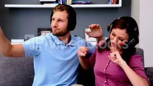 Couple listening to music and acting silly