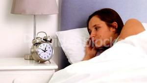 Woman waking up and realising she is late