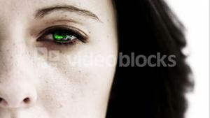 Girl opening her eye to reveal green scrolling data