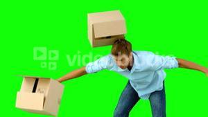Clumsy man dropping boxes over on green screen