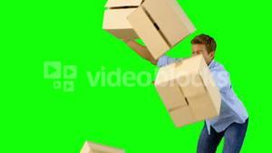 Clumsy man dropping boxes down on green screen