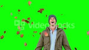 Amazed man looking at falling leaves on green screen