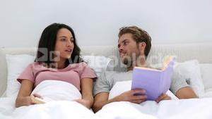 Couple talking about the books they are reading