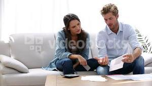 Couple feeling anxious about their bills