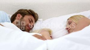 Parents and daughter sleeping together