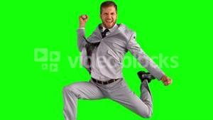 Happy businessman cheering and jumping