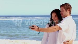 Attractive couple taking a self portrait