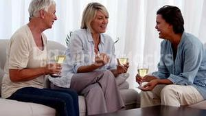 Old friends catching up over glasses of wine