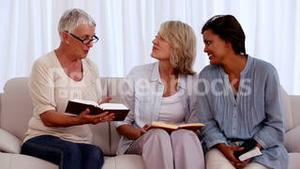 Retired friends studying the bible together