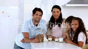 Family chatting and having cookies and milk