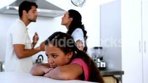 Little girl feeling sad as parents fight