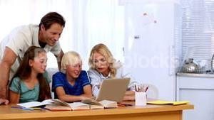 Family using the laptop together to do homework