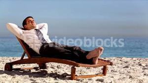Unstressed businessman relaxing on the beach