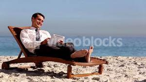 Unstressed businessman relaxing with a tablet pc