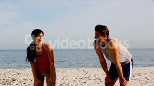 Two athletes running on the beach