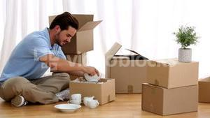 Man unpacking tableware