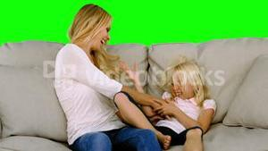 Mother tickling her daughter in slow motion