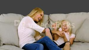 Mother having fun with her daughter in slow motion
