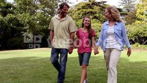 Family taking a walk in a park
