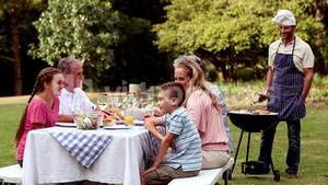 Happy family eating in a park