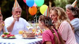 Family celebrating the birthday of a girl