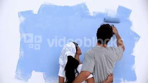 Lovely couple painting a wall