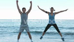 Attractive people working out on the beach
