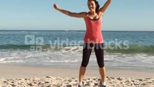 Woman running and jumping on the beach